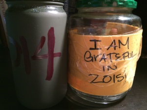 My 2014 Gratitude jar at left; my (almost) empty 2015 Gratitude Jar at right!